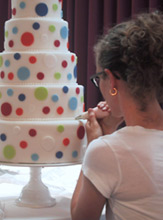 Zoë decorating a wedding cake
